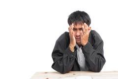 Ståendeshowaffärsman Headaches på vit bakgrund Fotografering för Bildbyråer