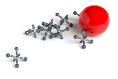 Stålar med den röda bollen på vit bakgrund arkivfoto