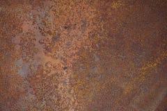 Stålgångbanamats besprutade röd rost arkivfoto