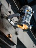 Stålsätta belägger med metall lampan Arkivbild