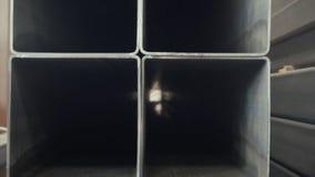 Stålsätta röret, fyrkantig hög bakgrund för kolmetallröret för tung bransch arkivbild
