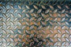 Stålsätta rutiga rostade metalltexturer för bakgrund Arkivfoton