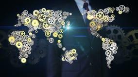 Stålsätter den rörande skärmen för affärsmannen, guld- kugghjul som gör den globala världskartan globalt förbind teknologi 1 arkivfilmer