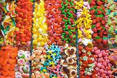 Stånd mycket av candys Royaltyfri Fotografi