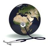 Stéthoscope écoutant la terre Photographie stock libre de droits