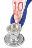 Stéthoscope avec le billet de banque Images libres de droits
