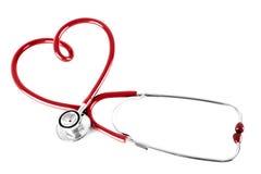 Stéthoscope dans la forme du coeur, d'isolement sur le petit morceau Images stock