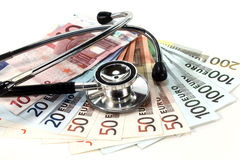 Stéthoscope et argent Photographie stock