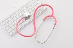 Stéthoscope et clavier Photos libres de droits