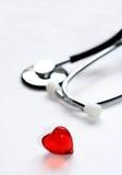 Stéthoscope et coeur Photos stock