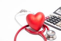 Stéthoscope et coeur rouge Photos stock