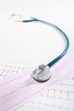 Stéthoscope et ECG Photos libres de droits