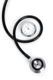 Stéthoscope et horloge photos libres de droits