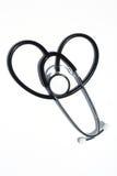 Stéthoscope sur le blanc dans la forme de coeur Photos stock
