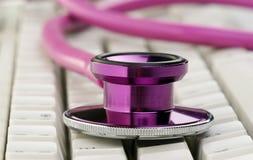 Stéthoscope sur le clavier Images libres de droits