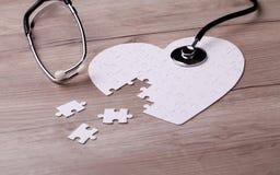 Stéthoscope sur le puzzle Photographie stock libre de droits