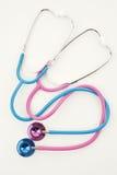 Stéthoscopes roses et bleus Photos stock