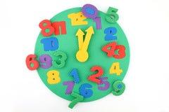 Störung der Zeit auf Spielzeugborduhr lizenzfreie stockbilder