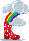 Stövlar & regnbåge Arkivbild