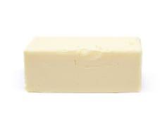 Stück des Kochens von Butter lokalisiert Stockfotos