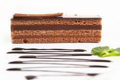 Stück des Schokoladenkuchens Stockfotos