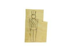 Stück Holz mit einer Bleistift-Zeichnung eines Soldaten Stockfotos