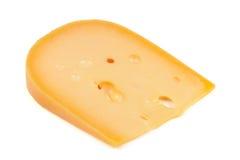 Stück Käse getrennt auf weißem Hintergrund lizenzfreie stockfotos