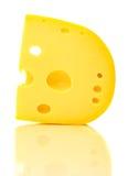 Stück Käse mit Löchern. Lizenzfreies Stockfoto