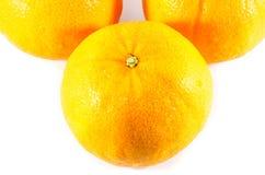 Stück orange Frucht im weißen Hintergrund Lizenzfreie Stockbilder