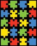 Stücke des bunten Puzzlespiels Lizenzfreie Stockfotos
