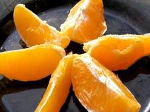 Stücke Orangen Stockbild
