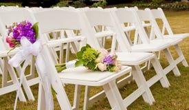 Stühle an einer Hochzeit Stockbilder
