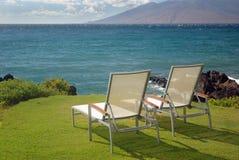 Stühle und Wasser Stockbild