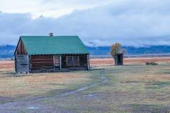 Stürmischer Tag am mormonischen Blockhaus Stockfotografie