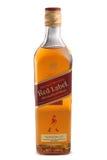 ST 彼得斯堡,俄罗斯- 2015年12月05日:瓶约翰妮步行者红色标签,被混和的苏格兰威士忌酒,苏格兰 免版税库存图片