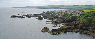 St Abbs, Berwickshire, Scotland. The small Scottish fishing village of St Abbs, in Berwickshire, Scotland, with the harbour and cliffs in the foreground stock photos