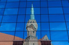 Reflection of church in the glass wall of shopping center royalty free stock photography