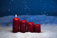 1st Advent. Candles in snow and snowfall Stock Photography