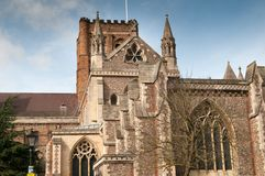 St Albans City cathedral exterior with blue sky above, religous building. City cathedral exterior on a bright sunny morning. Cathedral exterior of sacred place Stock Photo