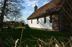 St Andrew Church, Didling, Sussex, UK. The isolated whitewashed 13th century church of St Andrews is situated half a kilometre from the tiny village of Didling stock photography