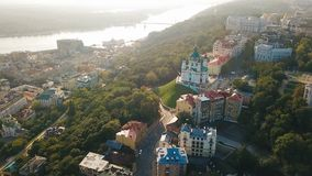 St.Andrew`s Church and Andriyivskyy Descent from aeriel above view. Kiev Ukraine. Morning soft sunrise backlight. European capital stock video footage
