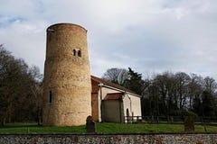 Historic English round towered church. stock photo