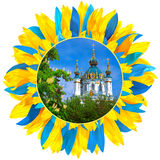 St Andrew's Church framed with petals in colors of Ukrainian fla. St Andrew's Church in Kyiv framed with petals in colors of Ukrainian flag stock images