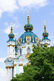 St. Andrew's Church in Kiev. St. Andrew's Church among trees (Kiev Royalty Free Stock Photography