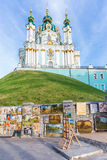 St. Andrew's Church in Kiev, Ukraine. Kyiv, Ukraine - 23.06.2015: Exhibition of paintings by street artists on the Andreevsky uzviz at St. Andrew's Church Stock Image