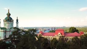St Andrew`s Church, Kiev Ukraine. View from above. aerial photo. Kiev attractions. video footage. camera rises from the. Bottom up. panaramic view to Podil stock video
