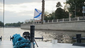 St. Andrew`s flag fluttering on a boat prow. Saint Petersburg. stock footage