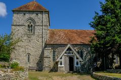 St. Andrews ancient church in the village of Jevington within the South Downs National Park. Jevington, Susssex, UK - August 1, 2018:  View of the  church of St stock photo