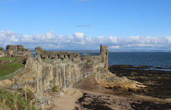 St Andrews Castle ruins St Andrews Fife, Scotland. Looking from the clifftop footpath towards the ruins of St Andrews Castle at St Andrews in the Kingdom of Fife royalty free stock images