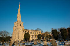St Andrews Church. And graveyard covered in snow against clear blue sky, Cambridge, UK stock photo